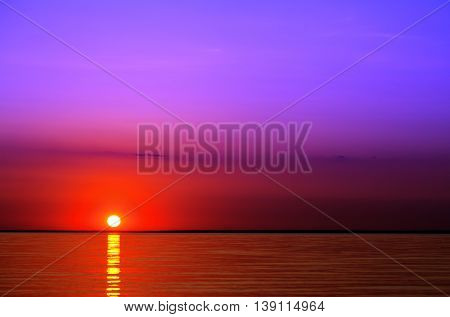 Sunrise on the lake in summer .