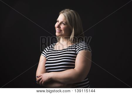 A Portrait of beautiful woman over black background