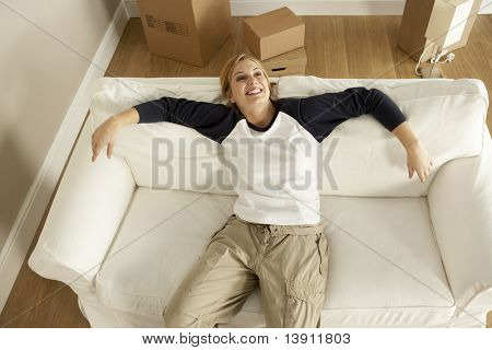 Overhead View Of Young Woman Moving Into New Home