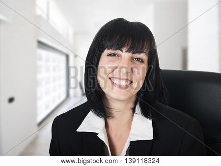young woman sitting happy in his office