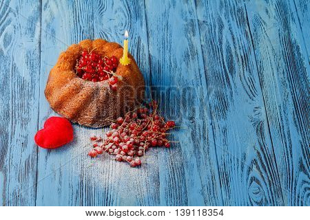 Ring Cakes With Red Berries On A Wooden Surface