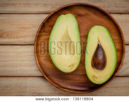 Healthy Food Concept.closeup Ripe Avocado On Wooden Background. Halved Organic Avocado With Core On