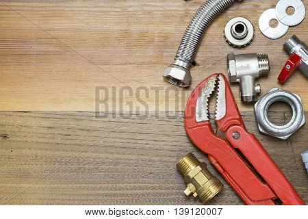 Thermostatic Valve And Plumber  Tools On Wooden Background