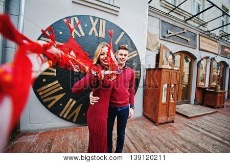 Young Beautiful Stylish Fashion Couple In A Red Dress In Love Story At The Old City, Play With Shawl