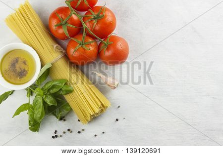 Ingredients for paste: spaghetti, basil, tomatoes, garlic, pepper, olive oil