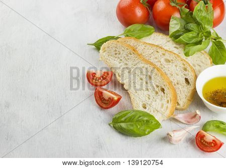Italian food: ciabatta, basil, tomatoes, garlic, pepper, olive oil