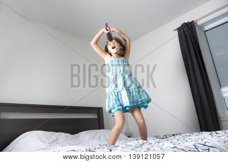 A girl singer having fun in the bedroom