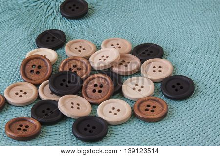 Wooden craft buttons on a blue background.
