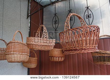 Vintage wicker baskets hanging on the market. Craft