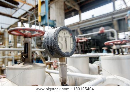 Pressure meter in natural gas processing plant in bright sunny summer day