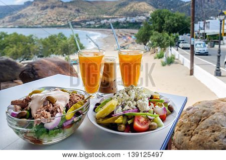 Traditional Greek food and orange juice on a table