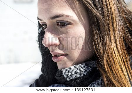 A worried woman in snow covered fields landscape