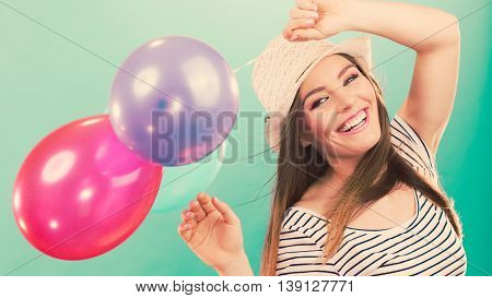 Joy and carefree. Lovely gorgeous smiling girl playing with colorful balloons. Young cute happy woman have fun in summer time.