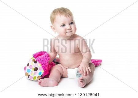 A Baby girl playing with a towel