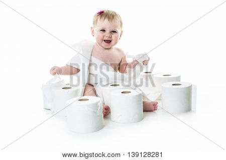 A Toddler ripping up toilet paper in studio white background