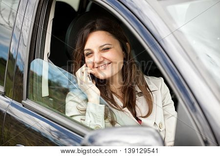 Woman Calling On Smartphone In Car.