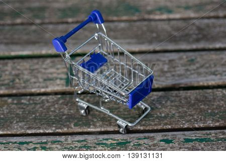 small shopping cart, on a wooden table
