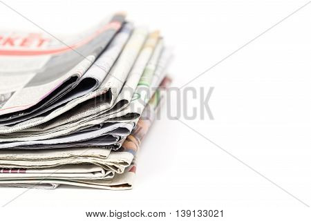 Stack of newspaper on white background with copyspace