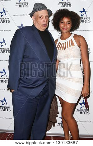 NEW YORK-OCT 19: Crime fiction writer Walter Mosely (L) and guest attend the 2015 National Arts Awards at Cipriani 42nd Street on October 19, 2015 in New York City.
