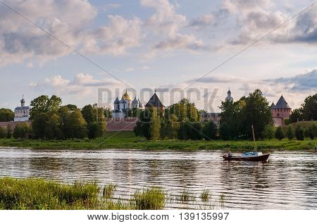 VELIKY NOVGOROD RUSSIA - JULY 17 2016. Architecture panoramic sunset landscape view of Novgorod Kremlin fortress and St Sophia cathedral on the bank of the Volkhov river - summer water landscape