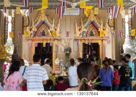 Samutprakarn, Thailand - July 19: Thai buddhists pray, donate offerings to temples and listen to sermons at buddhism temple on Asalha Puja day or Asalha bucha Day before Khao Phansa day.