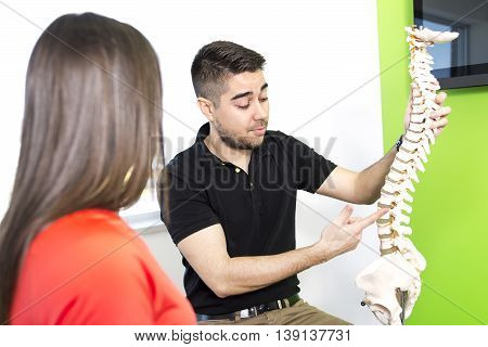 A Female Patient Describing talk to Injury To Osteopath