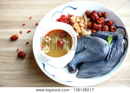 Double boiled chicken soup in Chinese style in white plate