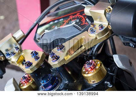 Close Up modern motorcycle detail with custom beautify. Golden and vivid color