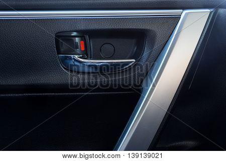 Door handle inside the modern car is black interior