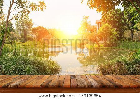 Wooden table view of lake and landscape in the morning background. For display or montage your products.