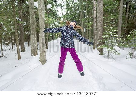 A Girl in winter clothes. Happy child outside photo