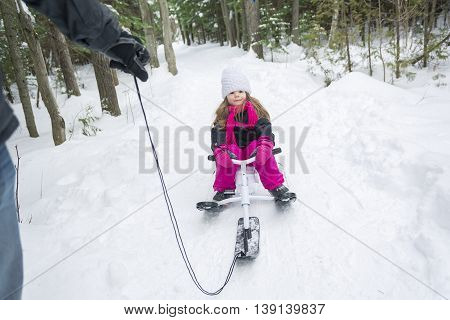 A Father and daughter outdoor in the winter forest