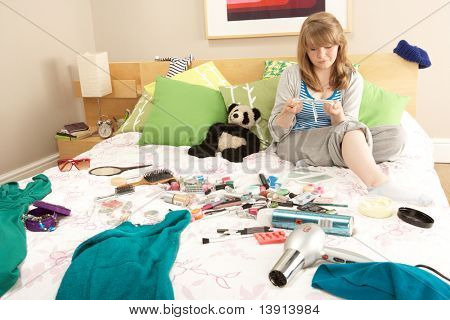 Teenage Girl In Untidy Bedroom Waxing Legs