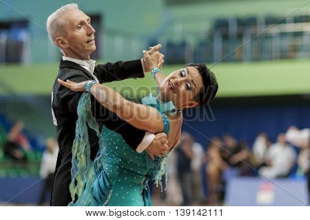 Minsk Belarus -May 29 2016: Senior Dance couple of Zhukov Evgeniy and Zhukova Irina performs Adult European Standard Program on National Championship of the Republic of Belarus in May 29 2016 in Minsk Belarus