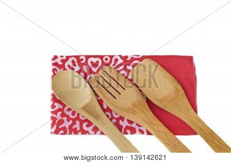 Wooden kitchen utensils isolated on white background