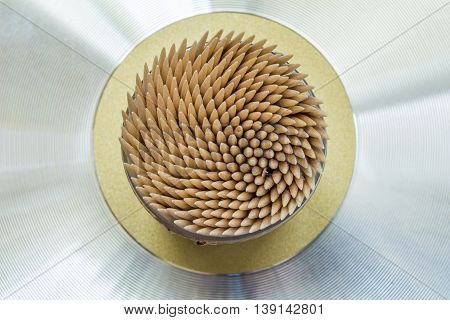 Abstract wooden toothpicks on a metal background