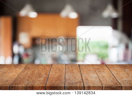 Perspective wooden with abstract blur coffee shop background, stock photo