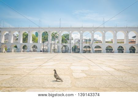 RIO DE JANEIRO BRAZIL - MARCH 06 2016: Landmark white arches of Arcos da Lapa under bright blue skies in Centro of Rio de Janeiro Brazil