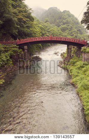 scenic Daiya river landscape with wooden red bridge in Nikko Japan