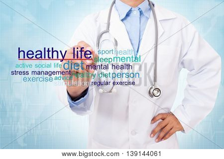 Doctor writing healthy life word. medical concept