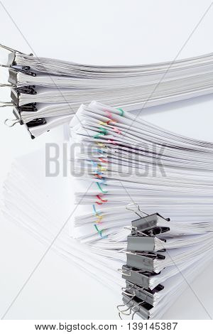 Paperwork With Paperclip Placed On White Table