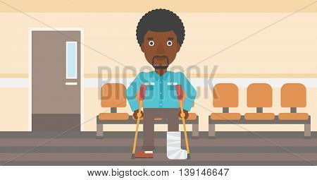 An african-american injured man with leg in plaster using crutches while standing in the hospital corridor. Vector flat design illustration. Horizontal layout.