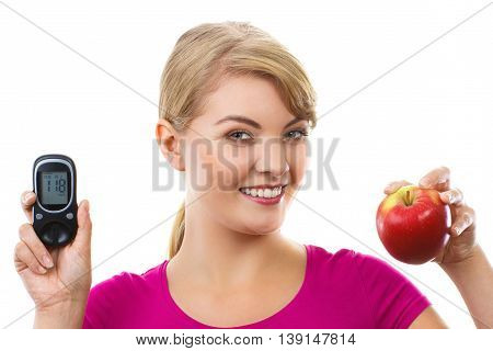 Happy Woman Holding Glucometer And Fresh Apple, Measuring And Checking Sugar Level, Concept Of Diabe