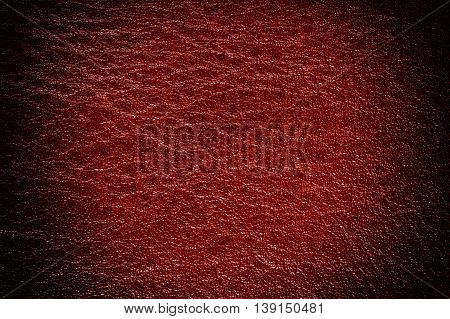 Red decorative leather texture background, close up