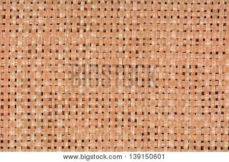 Decorative basketweave placemat texture background, close up