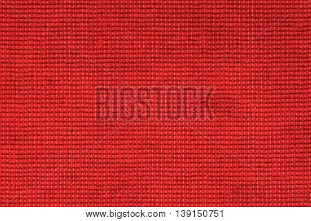 Red polyester fabric texture background, close up