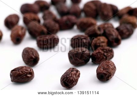 Dried dates isolated on white background
