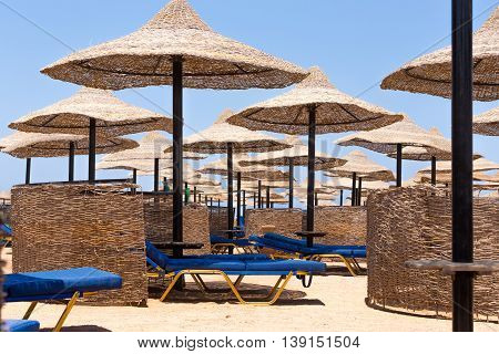 Beach Umbrellas And Blue Sky Background