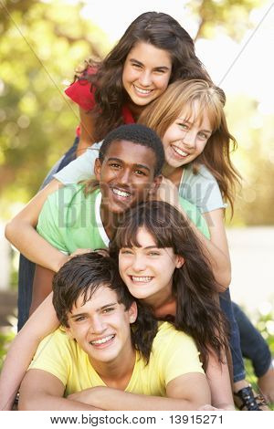 Group Of Teenagers Piled Up In Park