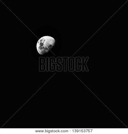 An almost-full moon in a starless night sky